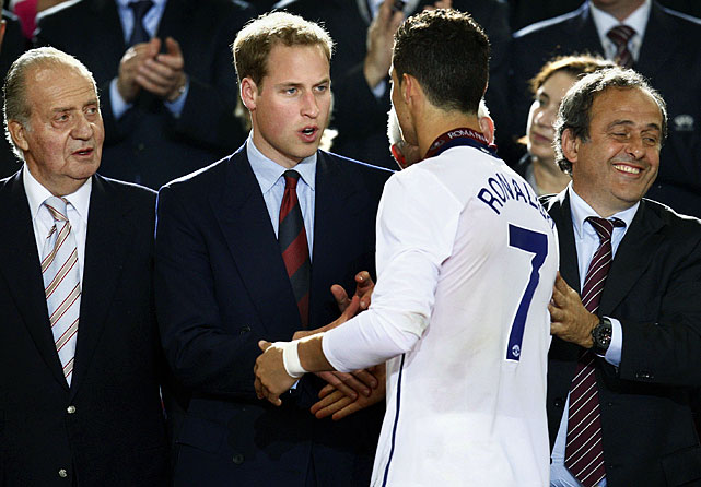 Cristiano Ronaldo shakes hands with Prince William at the end of the UEFA Champions League final soccer match between Manchester United and Barcelona in Rome. Barcelona won 2-0.