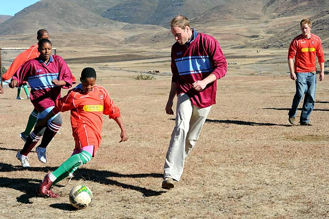 Princes William and Prince Harry play football with orphaned children during a visit to the Semongkong Children's Centre in Lesotho in South Africa.