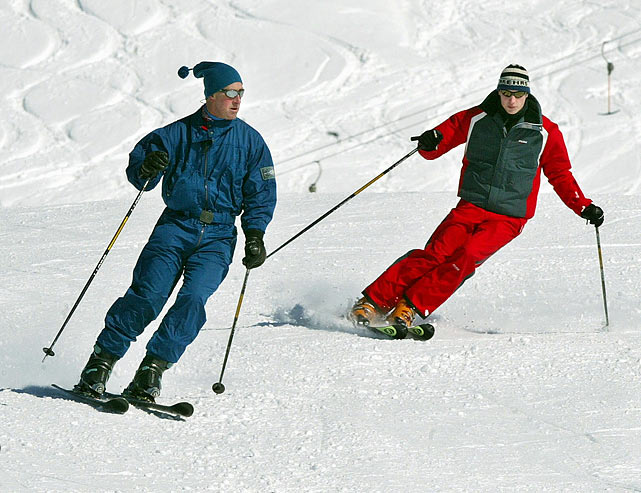 Prince Charles and Prince William ski down the Madrisa course in Klosters, Switzerland.