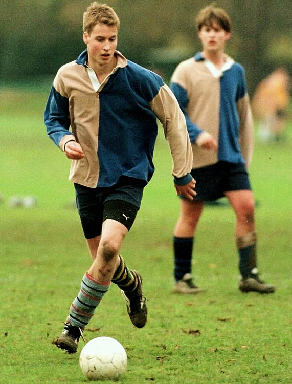 Prince William chases a soccer ball during a school inter-house match in Eton, England.