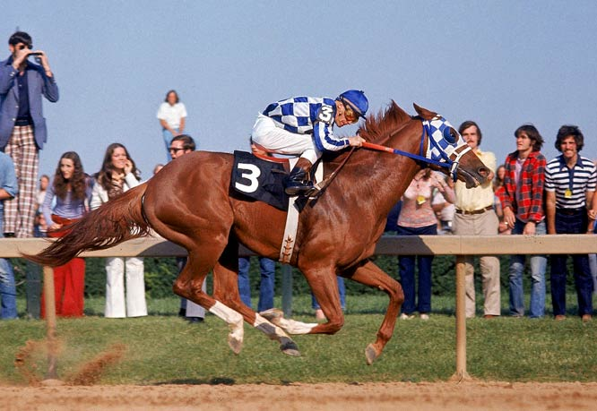 Secretariat didn't just win the 1973 Belmont to cap the first Triple Crown in 25 years. Big Red redefined greatness in horse racing. Another colt, Sham, was still close as they headed toward the backstretch, but Secretariat broke free and continued to pull farther and farther ahead. The 31-length victory and track-record time of 2:24 marked Secretariat as the greatest horse of his generation.