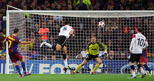 David Villa, who took a feed from Lionel Messi, arched a shot toward the goal that goalkeeper Edwin van der Sar seemed to have a beat on ...