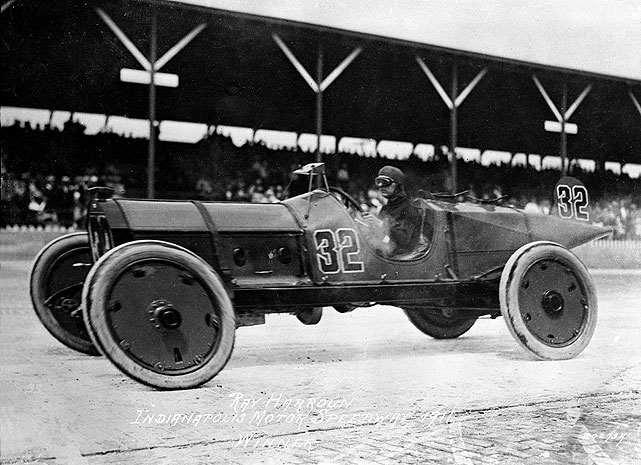 "In the very first 500-mile race, Ray Harroun gave the automotive industry one of its greatest safety innovations when he rigged a mirror above the dashboard of his race car so he could see oncoming traffic. By doing so, he did not have to use a ""riding mechanic,"" which gave him an advantage in the race. Though he still needed a relief driver, Harroun was in the cockpit for the last part of the race and drove to a 1:43.00 margin of victory over Ralph Mulford. Harroun retired after the race, claiming 500 miles was ""too long."" ""It's too dangerous,"" he said. ""That race was the worst I was ever in, see?"""