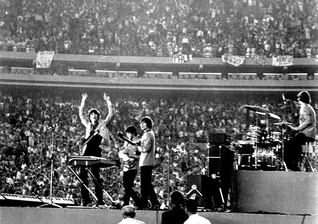 "The band performs as ""Beatlemania"" swept the United States."