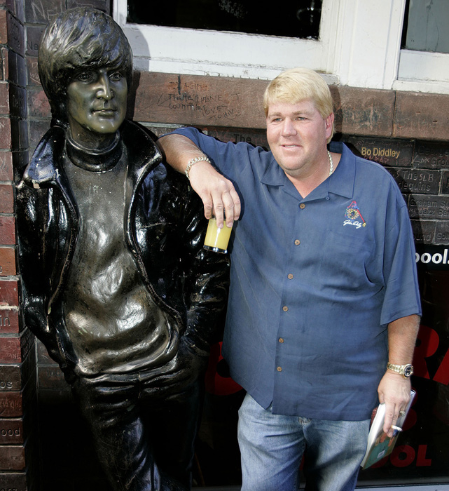 The outspoken former British Open champion stands next to a statue of John Lennon before performing at The Cavern Club, which was made famous in the 1960s by the Beatles. Daly, in England to compete in the British Open, sang to around 300 fans to celebrate the publication of his autobiography, My Life In & Out of the Rough .