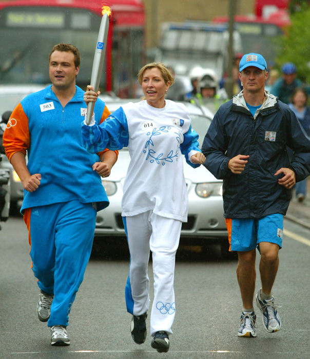 The then-wife of Sir Paul McCartney carries the Olympic torch in its relay across London in June 26. Mills and McCartney divorced in 2008, with the former Beatle reportedly paying $35 million in the settlement.