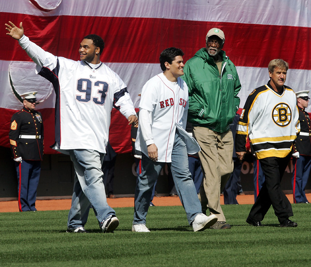 Patriots stars Richard Seymour and Tedy Bruschi, Russell and former Bruins star Bobby Orr walk to the mound to toss the first pitch before the Red Sox home opener against the Yankees on April 11, 2005. After the Red Sox banished the Curse of the Bambino the previous fall, the team brought in some of Boston's biggest champions for the ceremony.