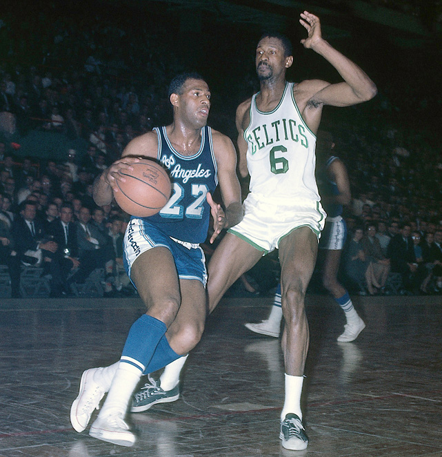 Hall of Famer Elgin Baylor dribbles up court against Russell in 1963. Russell defeated Baylor's Lakers for seven of his 11 NBA championships.