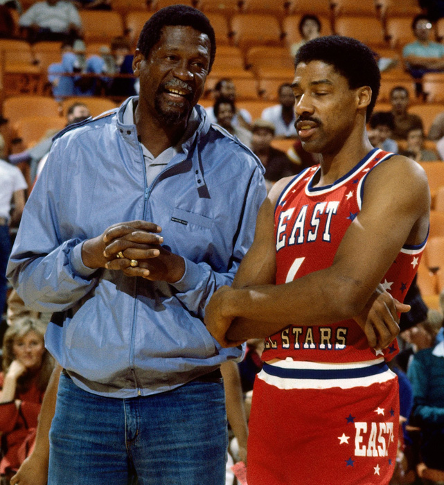 Russell chats with Julius Erving before the 1983 All-Star game at the Forum in Inglewood, Calif. Dr. J won the game's MVP award after leading the East to a 132-123 win.