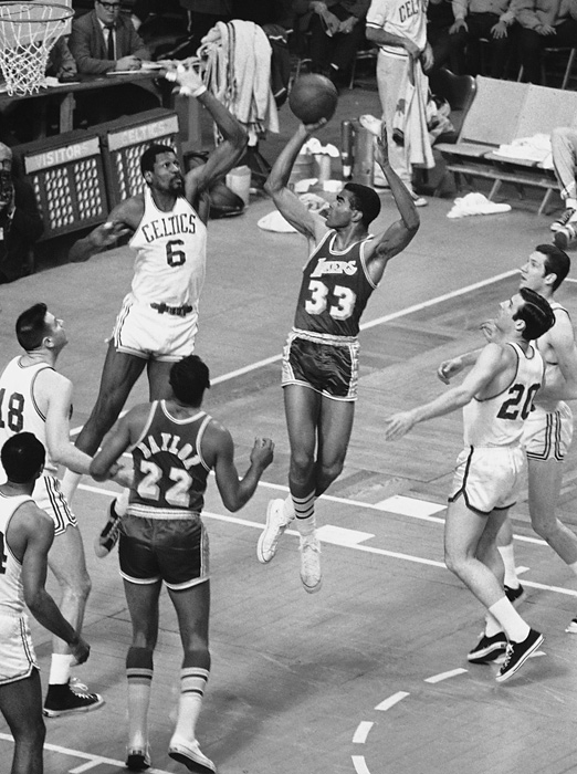 Russell leaps to block a shot from Glen Hawkins in the second game of the 1968 finals. After recovering from a three-games-to-one deficit against the 76ers in the Eastern Conference finals, the Celtics beat the Lakers in six games for Russell's 10th title in 12 seasons.