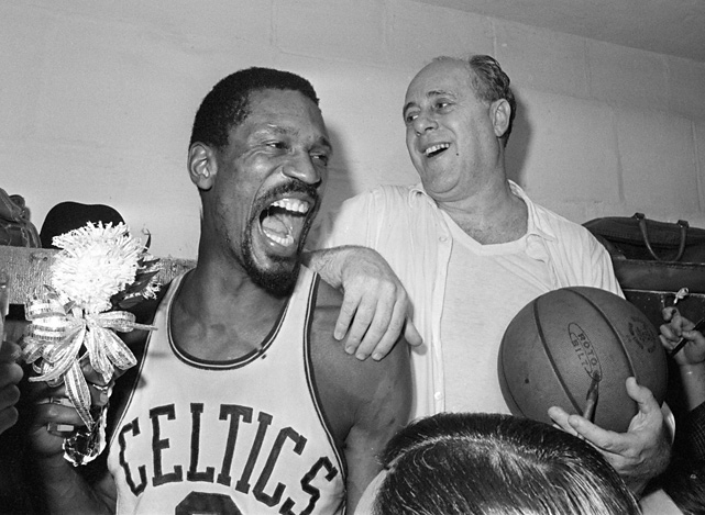 Russell holds a corsage as he and coach Red Auerbach celebrate the Celtics eighth straight title in 1966. The team defeated the Lakers 95-93 to win the crown.