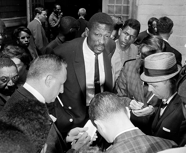 Russell talks with the media in 1963 after speaking with an estimated 3,000 children who had boycotted Boston Public Schools that day to protest what parents said was actual -- if not legal -- segregation. Russell has worked toward racial equality during his life.