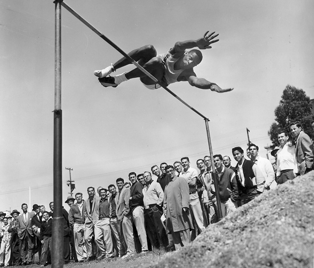 While at the University of San Francisco, Russell also competed in track and field. Shown here in the high jump, Russell was attempting to clear 6-9 1/4. He tied for third at this meet in Los Angeles by clearing 6-6 1/4.