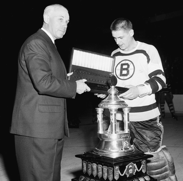 The Bruins goalie receives the Vezina Trophy from NHL President Clarence Campbell. It was the third Vezina in four years for Sawchuk, who had just arrived from the Red Wings that offseason. He would spend only two years in Boston before returning to Detroit.