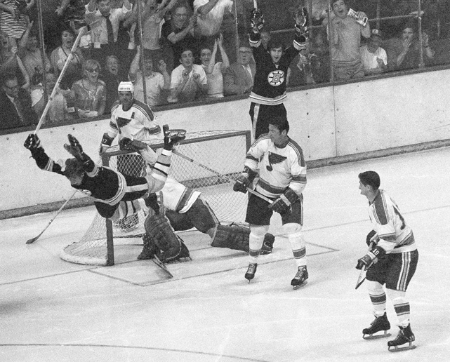 The defenseman who revolutionized the NHL game with his offensive flair flies through the air in this iconic photo after scoring the series-winning goal in the Stanley Cup Final against the St. Louis Blues. The Bruins unveiled a statue of the man many consider to be the greatest all-around blueliner in NHL history, on the 40th anniversary of this goal.