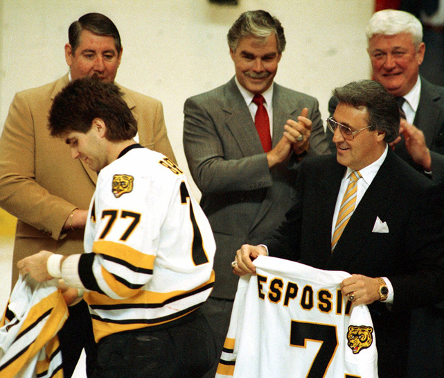 The star defenseman shows off his new jersey number, 77, at a pre-game celebration for former Bruins great Phil Esposito. Bourque gave up the number 7 as Esposito's old jersey number was retired. After playing more than 20 seasons with the Bruins, Bourque joined Esposito in the Hockey Hall of Fame in 2004.