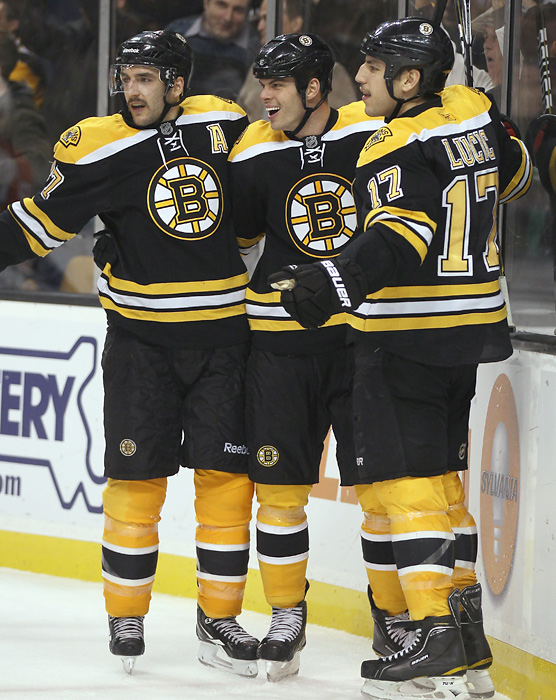 The Bruins teammates celebrate after Lucic scored his second goal of a game against the Panthers in November. The trio finished 1-2-3 on the team in goal-scoring during the regular season, led by Lucic's 30. Horton would become a clutch performer during the 2011 postseason, including his Eastern Conference Finals-winning goal over the Lightning in Game 7.