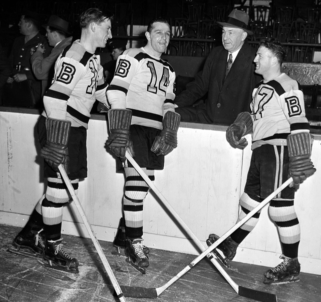 Milt Schmidt, Porky Dumart and Bobby Bauer chat with manager Arthur Ross on their return from service in World War II with the Royal Canadian Air Force. The line was dominant in its time together, finishing 1-2-3 in scoring during the 1939-40 season. The trio also led Boston to the 1939 and 1941 Stanley Cups.