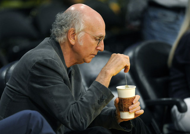 "The star of ""Curb Your Enthusiasm"" enjoys some ... hot tea? ... at the Lakers game."