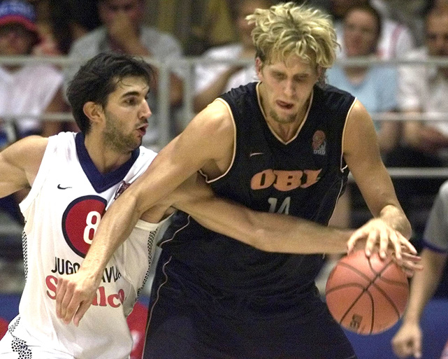 An NBA battle continues overseas as Kings forward Peja Stojakovic (Yugoslavia) guards Mavericks forward Nowitzki during the European Basketball Championship in Turkey.