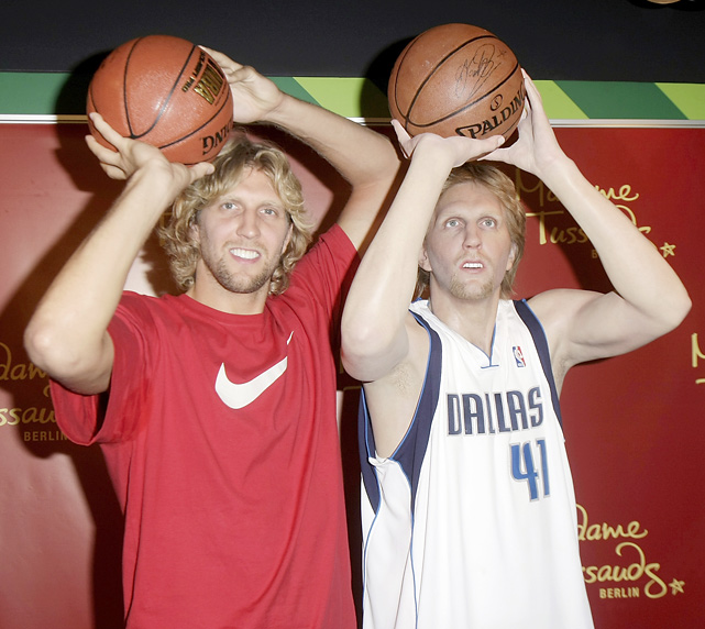Nowitzki mimics the pose of his wax figure as it's unveiled at Madam Tussauds in Berlin.