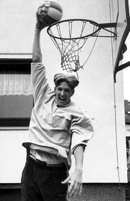 Nowitzki plays basketball in front of his parent's house in Wurzburg, Germany. He had just finished his second season with local team DJK Wurzburg. After struggling some in his first season, he became a starter in the second year.
