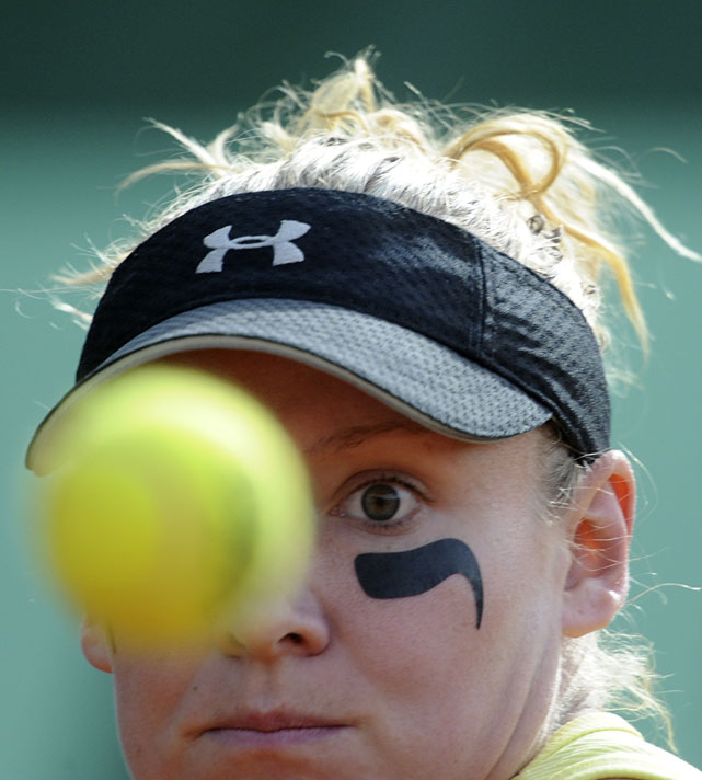 Bethanie Mattek-Sands of the United States eyes the ball as she plays Spain's Arantxa Parra Santonja in the first round. Mattek-Sands won 2-6, 7-6(5), 6-3.