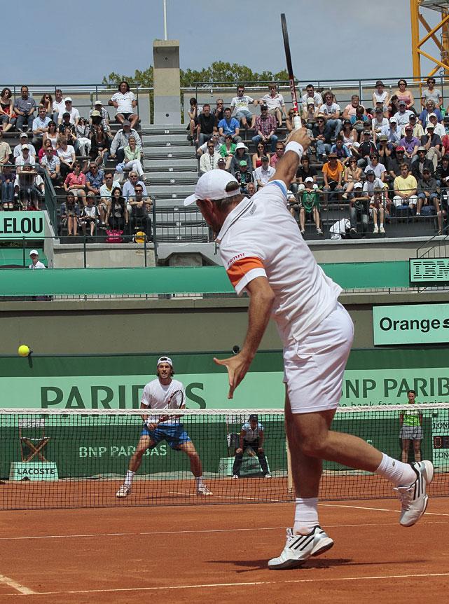 Switzerland's Stanislas Wawrinka hits a return to France's Augustin Gensse during their first-round match. Wawrinka won 4-6, 6-3, 6-4, 6-2.