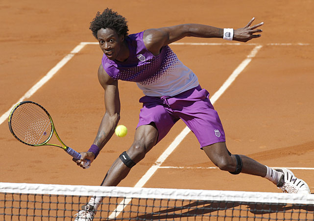 France's Gael Monfils returns the ball to Germany's Bjorn Phau during their first-round match. Monfils won 4-6, 6-3, 7-5, 6-0.