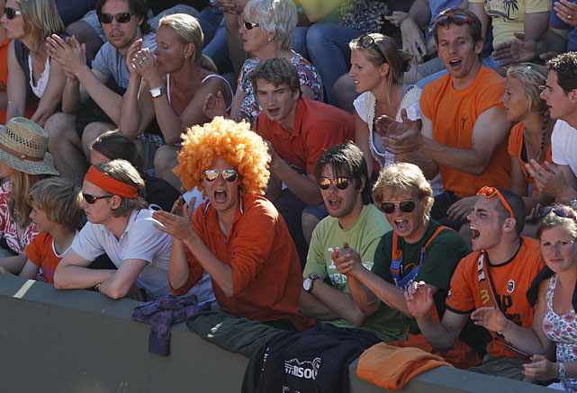 Dutch fans dressed in orange cheer Thomas Schoorel of the Netherlands as he plays Maximo Gonzalez of Argentina. Schoorel won 7-6(5), 6-3, 6-3.
