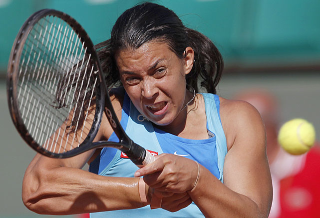 Marion Bartoli of France returns the ball during her match against Anna Tatishvili of Georgia. Bartoli won 1-6, 6-2, 6-1.