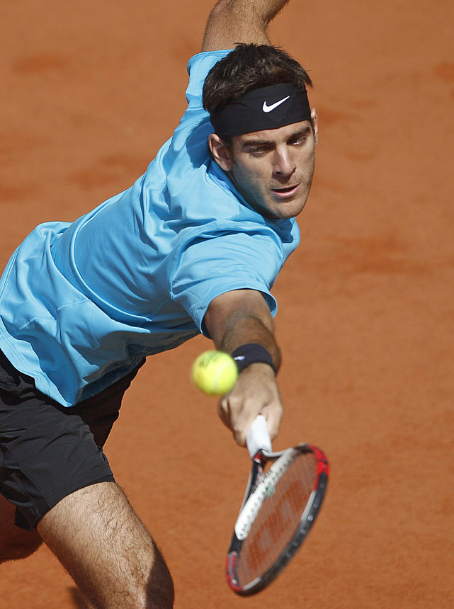 Argentina's Juan Martin del Potro of Argentina returns the ball to Ivo Karlovic of Croatia during their first-round match. Del Potro won 6-7(7), 6-3, 7-5, 6-4.