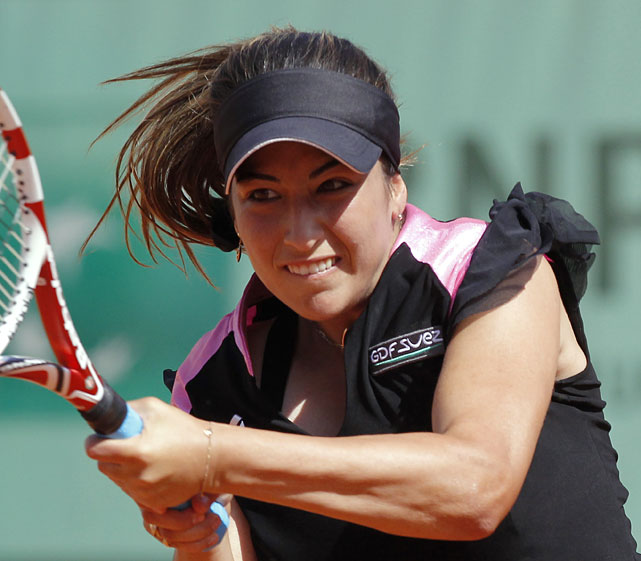 France's Aravane Rezai hits a return to Romania's Irina-Camelia Begu during their first round match. Rezai lost 6-3, 6-3.