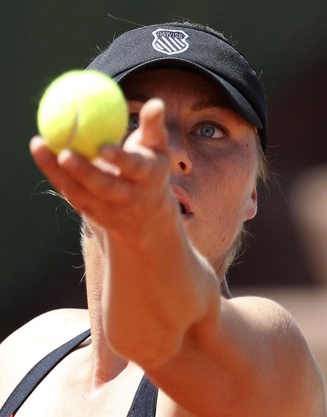 Russia's Vera Zvoranova serves to Spain's Lourdes Dominguez Lino. Zvonareva won 6-3, 6-3.