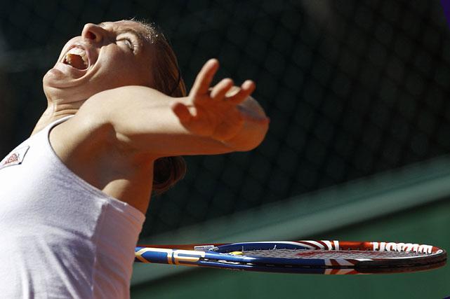Sara Errani of Italy arches back as she serves against Daniela Hantuchova.