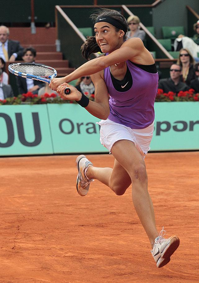 Caroline Garcia returns the ball to Maria Sharapova during their match.