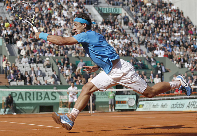 Spain's Rafael Nadal returns against compatriot Pablo Andujar during their second-round match. Nadal won 7-5, 6-3, 7-6(4).