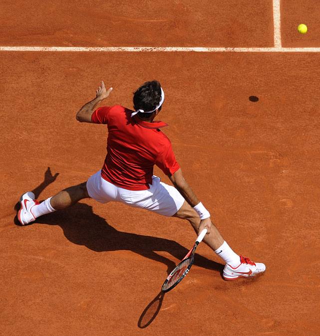 Roger Federer returns the ball to Serbia's Janko Tipsarevic during their third-round match. Federer won in straight sets.
