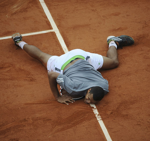 France's Jo-Wilfried Tsonga falls on the clay during his five-set thriller against Stanislas Wawrinka. Tsonga succumbed 4-6, 6-7(3), 7-6(5), 6-2, 6-3.