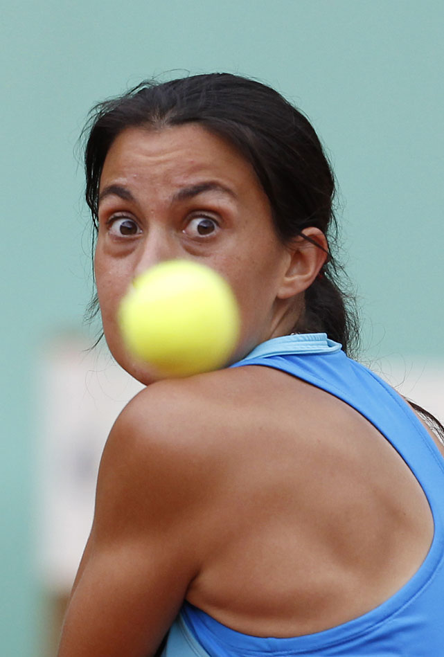 France's Marion Bartoli eyes the ball during her third-round match with Germany's Julia Georges. Bartoli won 3-6, 6-2, 6-4.