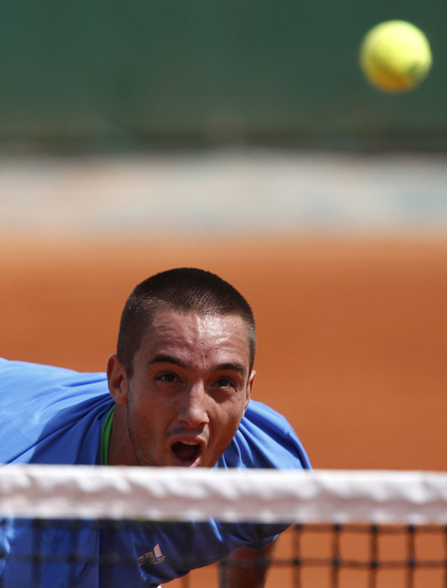 Serbia's Viktor Troicki eyes the ball as he plays Ukraine's Alexandr Dolgopolov during their third-round match. Troicki won 6-4, 3-6, 6-3, 6-4.
