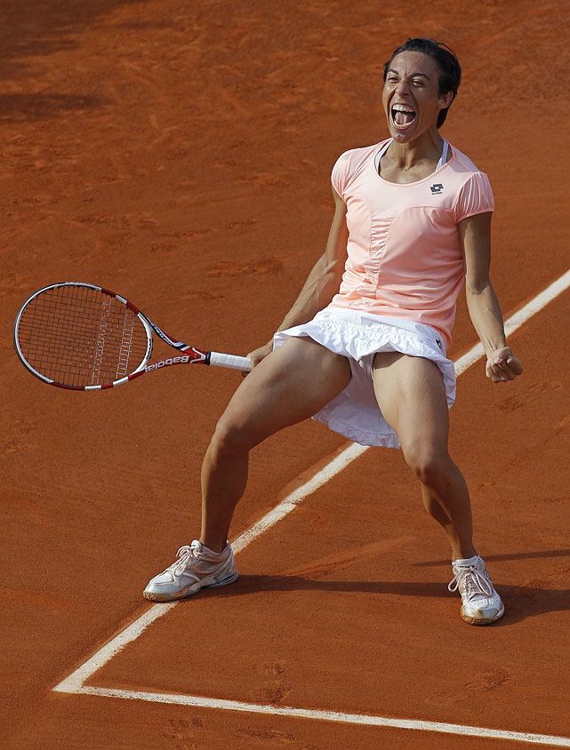 Francesca Schiavone celebrates after winning 6-3, 2-6, 6-4 against Serbia's Jelena Jankovic.