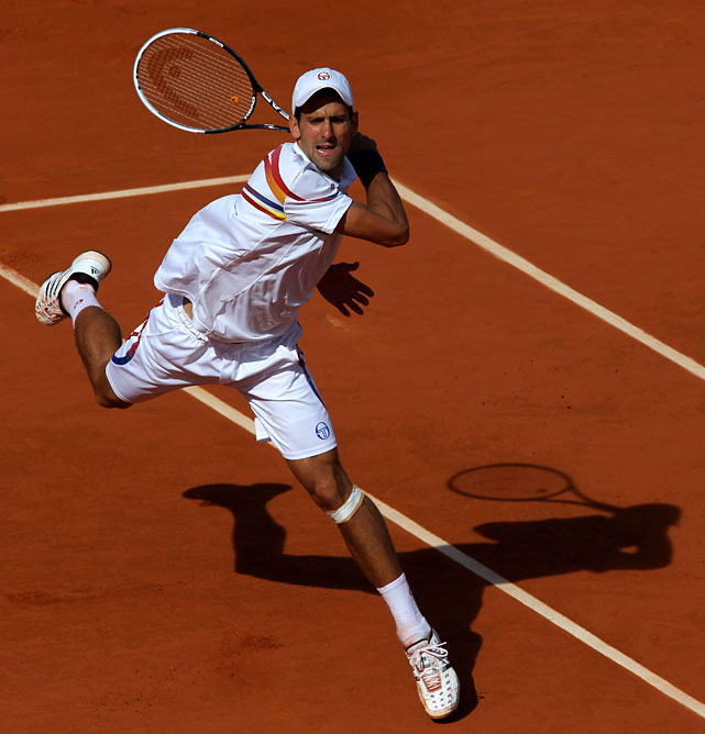 Novak Djokovic of Serbia hits a forehand during his fourth-round match with France's Richard Gasquet. Djokovic won 6-4, 6-4, 6-2.