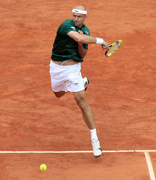 Ivan Ljubicic returns to Rafael Nadal during their fourth-round match.