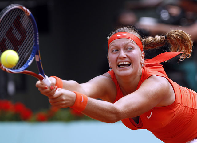 Petra Kvitova stretches to returns the ball to Li Na during their fourth-round match.
