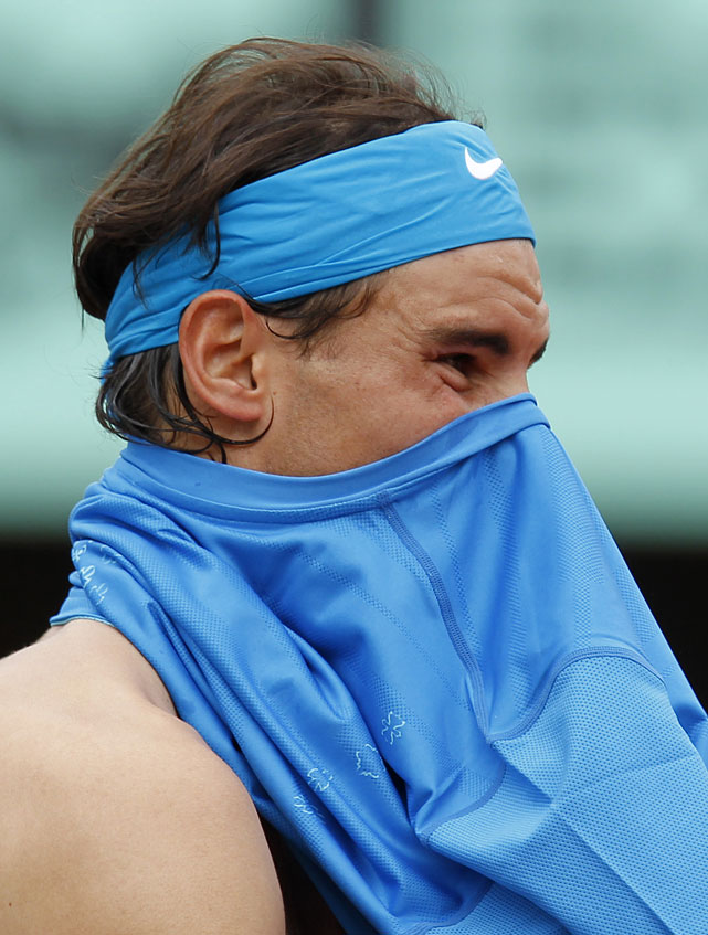 Rafael Nadal changes his shirt during Monday's match with Ivan Ljubicic.