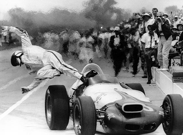 The defending champion escapes a flaming car in the pits during the 1964 Indy 500. He had led seven of the 55 laps he completed before the fire forced him out of the race.
