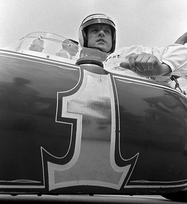 Defending Indy 500 champion A.J. Foyt sits in his No. 1 Lotus before the race. He qualified for the pole position, but finished 15th. Jim Clark became the first foreign driver to win the race in 49 years.