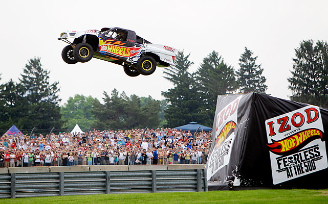 Professional stunt driver Tanner Foust flies through the air on the way to setting a new world record by jumping 332 feet in a Pro 2 truck at the Indianapolis Motor Speedway before the Indianapolis 500. The toy brand Hot Wheels installed a giant ramp at the historic speedway hoping to break Johnny Greaves' current world record of 301 feet.