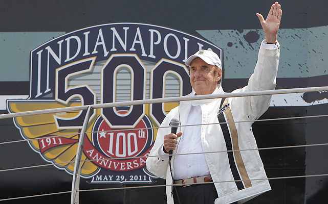 "Jim Nabors waves before singing ""Back Home Again in Indiana"" before the Indianapolis 500 auto race at the Indianapolis Motor Speedway."
